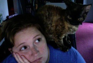 Girl with cat on shoulder